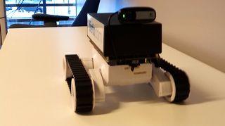 Kuvassa telaketjuilla liikkuva robotti.