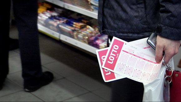Queuing to purchase a lottery ticket.