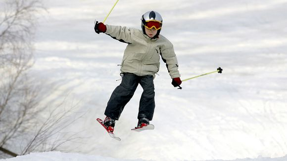 boy jumping with mini-skis