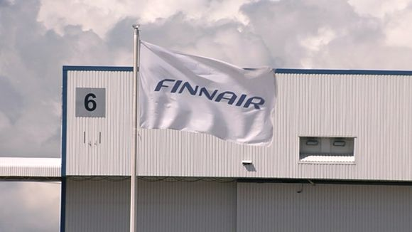 Finnair flag flutters at the Helsinki-Vantaa airport.