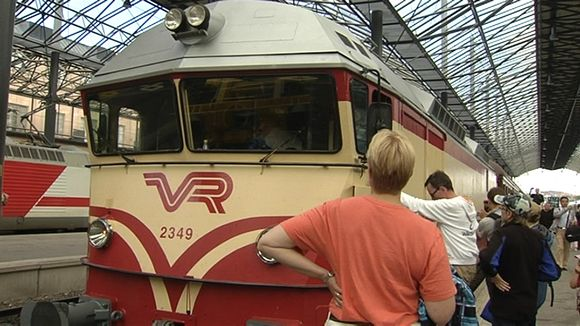 People looking at a vintage train in Helsinki on August 4. 