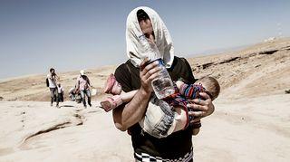 Syyrian kurdeja pakenee Irakiin.
