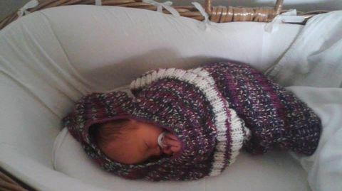 Vauva toukkapussissa.