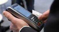 Etäluettava pankkikortti ja lukulaite.