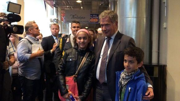 Aya Al-Shmes, Sauli Niinistö ja Fares Al-Shmes Tampereella