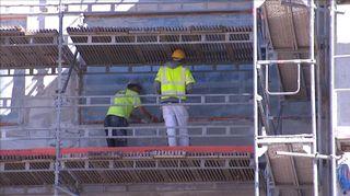 Työläisiä rakennustyömaalla.