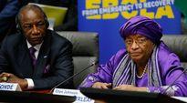 Guinean presidentti Alpha Conde (vas.) ja Liberian presidentti Ellen Johnson Sirleaf puhuivat Brysselissä 3. maaliskuuta.