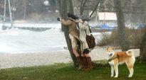 Ihmiset koittavat valokuvata myrskyävää järveä, Ammerseeta, Herrschingin-kylässä Etelä-Saksassa 31. maaliskuuta.
