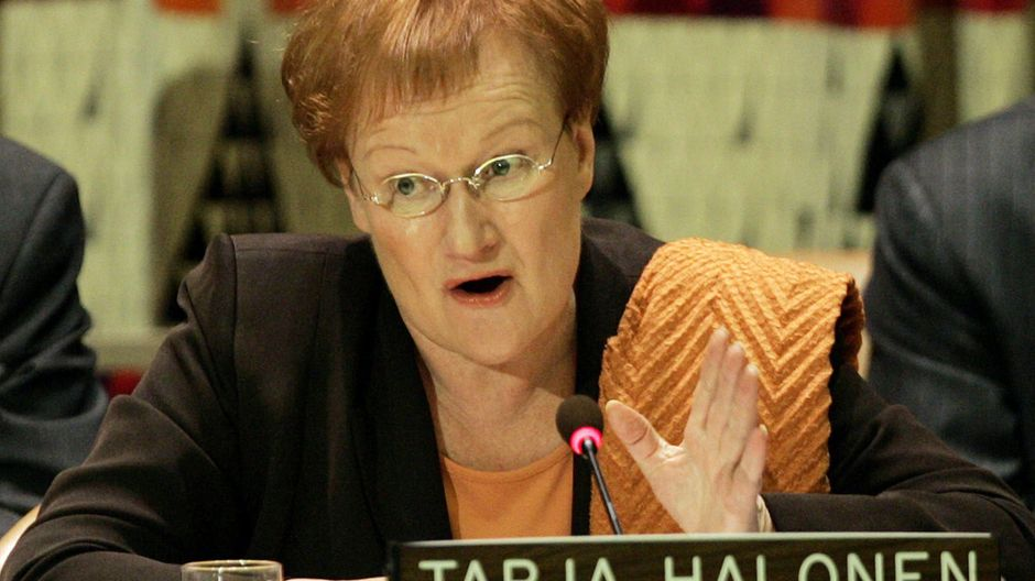 epa000279058 Finland's President Tarja Halonen gestures as she addressesd the high level meeting entitled 'A Fair Globalization Implementing the United Nations Millennium Declaration' at UN Headquarters in New York City Monday 20 September 2004. The General Debate of the General Assembly begins Tuesday 21 September at UN Headquarters