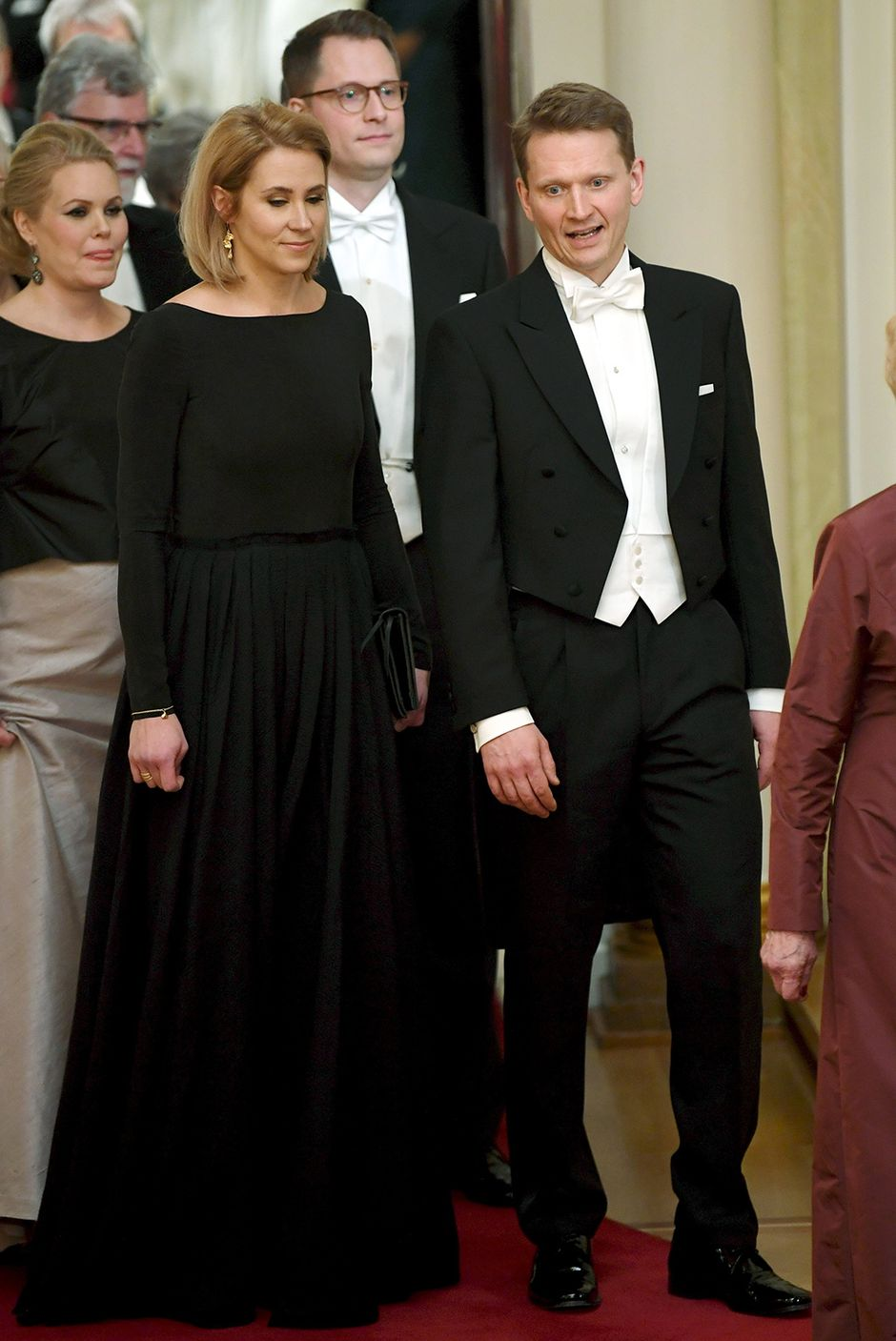 Nuutti ja Saara Niinistö perässään Matias Niinistö ja Liisa Kajaste.