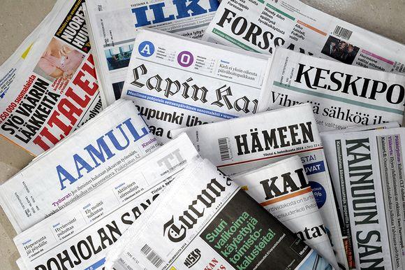 12 sanomalehteä.