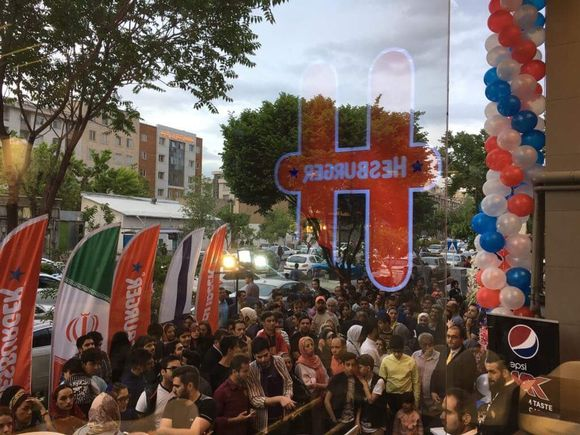 The view of a crowd lined up outside Hesburger's new location in Tehran, Iran, which opened for the first time on Friday.