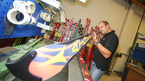 Amer Sports worker who controls the quality of an Atomic ski at Homebase in Altenmarkt, Austria on 2013/09/26