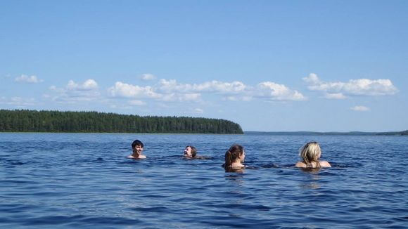 Taking the plunge during Midsummer in Finland.