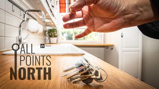 Photo of hand dropping keys on kitchen counter featuring All Points North Podcast logo.