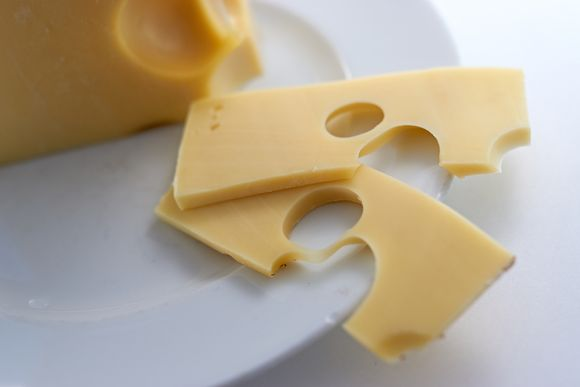 A block and tw slices of cheese.