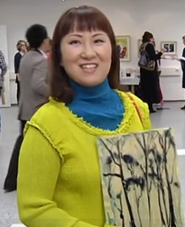Artist Hiroko Imada demonstrates the Japanese technique of lithography on plywood used in her new exhibition Finlandia Rhapsody, in Vantaa