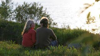Couple under midnight sun in northern Finland.