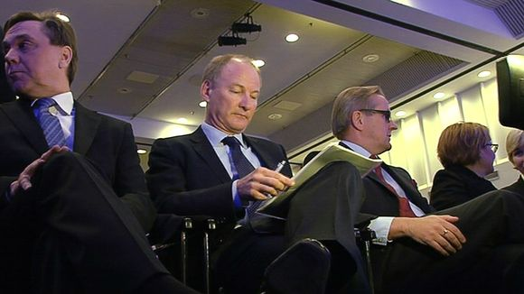 Finnair board member Harri Kerminen, CEO Mika Vehviläinen and chair Harri Sailas at last spring's annual general meeting.