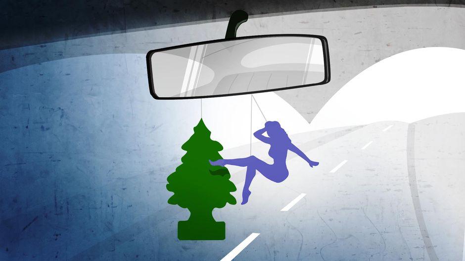 Wundrbaum ja naisfiguuri auton sisäpeilissä.