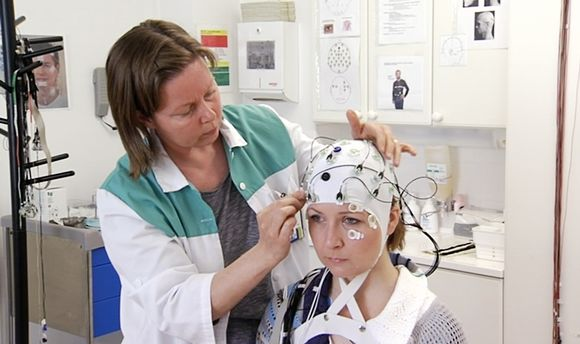 A test subject is fitted with sensors at the Institute of Occupational Health's brain lab.