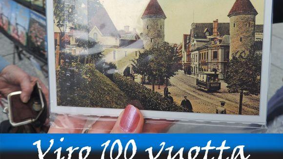 Vanhaa Tallinna esittävä postikortti turistin kädessä.