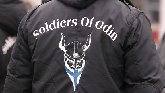 Police hold four following scuffle during Soldiers of Odin procession