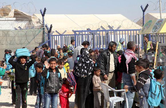 Syyrian pakolaisia pakolaisleirillä lähellä Mafragan kaupunkia.