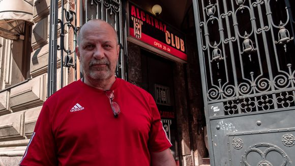 Kenneth Eriksson stands outside Helsinki strip club Alcatraz.