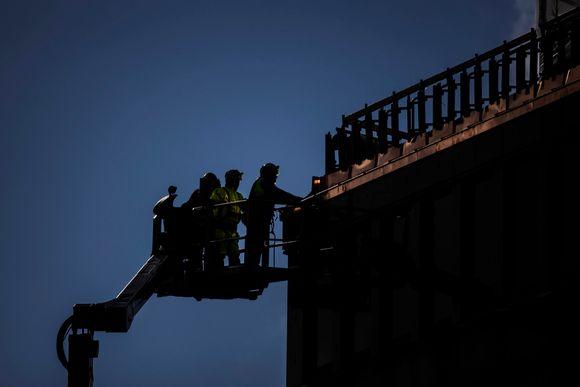 Kuvassa on rakennustyöläisiä Helsingin keskustassa lokakuussa 2020.
